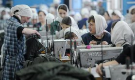 Russian female prisoners at sewing machines.