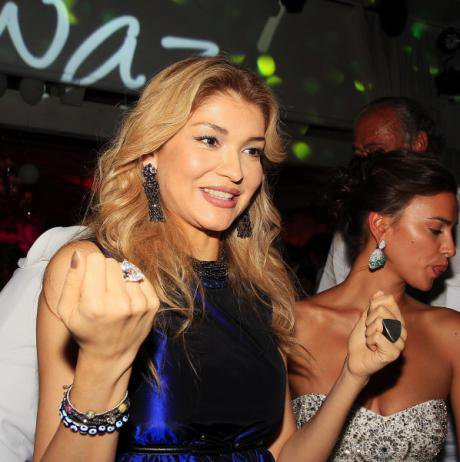 Karimova at a public function in an expensive dress.