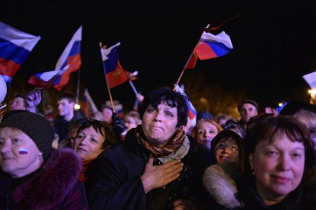 Crimeans with Russian flags celebrate the passing of their referendum calling for unification with Russia.