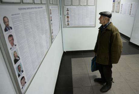 A Kyiv man weighs his options.
