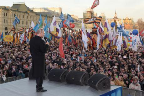 Putin addresses a crowd at a celebration of the one year anniversary of the 'return' of Crimea to Russia.