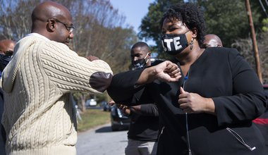 Reverend Raphael Warnock, Democratic candidate for Senate, greets Stacey Abrams during a campaign event in Atlanta, GA, 3 November 2020
