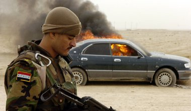 Iraqi Army Col. Msfab Yousif reloads his AK-47 after using it to destroy a vehicle that was used in illegal checkpoint activities by insurgents in Ad Dawr near Tikrit; Iraq; November 21