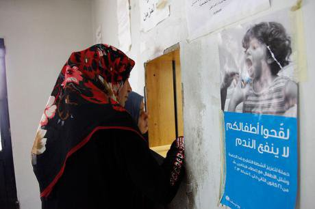 Two_Syrian_women_wait_to_collect_a_prescription_at_a_health_clinic_in_Lebanons_Bekaa_Valley_(11174124425).jpg