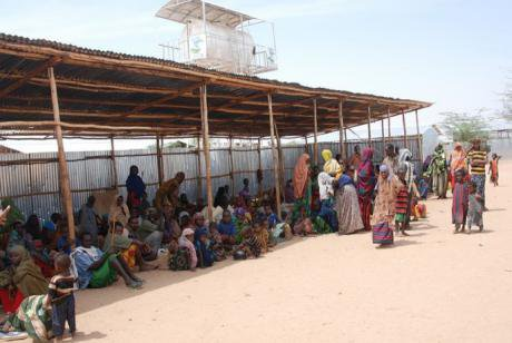 New arrivals rest in the shade at the Dollo Ado reception center, Ethiopia, after their long journey from Somalia