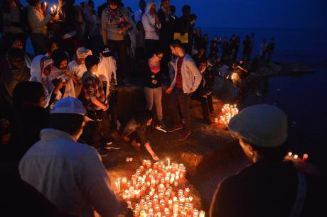 Vigil for migrants who drowned in the Mediterranean, Sliema, Malta. Ian Pace/Demotix. All rights reserved.