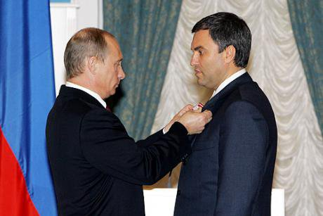 Putin awards Vyacheslav Volodin with a medal for 'Services to the Fatherland' in 2006.