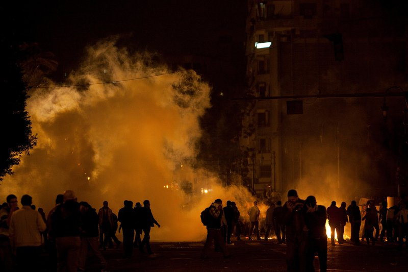 People are seen in front of huge plumes of smoke in Egypt's Tahrir Square