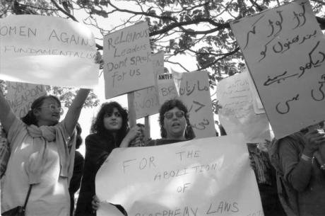 Small group of women with banners