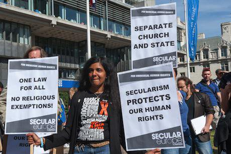 Woman with placards at Secular Europe rally in London. Peter Marshall:Demotix. All rights reserved.jpg