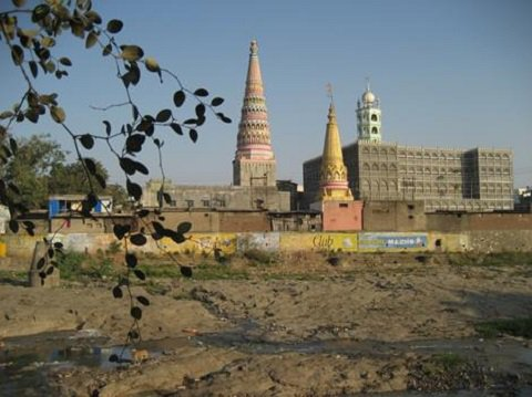 Two colourful conical towers and a minaret