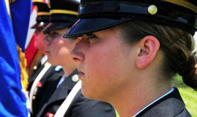 Women soldiers in a military line-up.