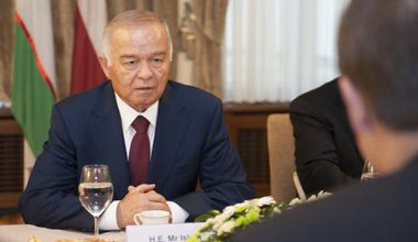 Uzbekistan's strongman, Islam Karimov  pictured at a regional summit in a suit and tie. He is an old looking man.