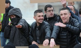 Dieudonné sympathisers make the 'quenelle' gesture in support of the comic in Lyon. Demotix/Serge Mouraret. All rights reserved.