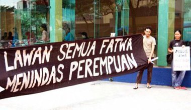 People holding a large banner