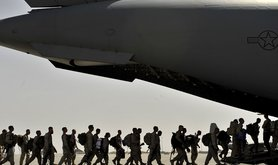 Marines board an Air Force C-17 Globemaster III as they redeploy from Camp Bastion Airfield, Afghanistan, Sept. 11, 2012. U.S. Transportation Command has a sophisticated planning process to ensure it can support U.S. Central Command as it redeploys forces