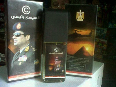 Cologne bottle and box with Sisi's image on them and Arabic text