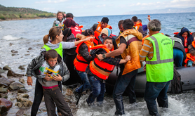 Refugees arrive in boats on European shores.