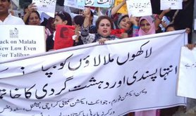 Pakistani women protesting with banners and signs