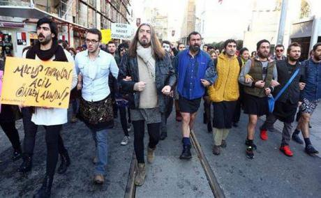 Men march with linked arms