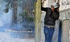 Cairo protester with door and saucepan as shields