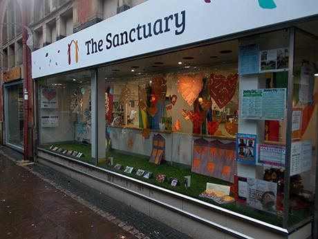 Large shop front with the Sanctuary written in bold letters along a glass window