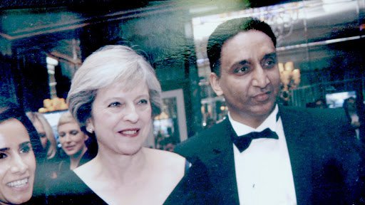 Sam Singh with the previous Conservative prime minister, Theresa May