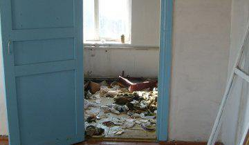 The Kurganka First Aid Station, which was listed as 'operational' for 10 years, in a state of disrepair, covered in rubbish