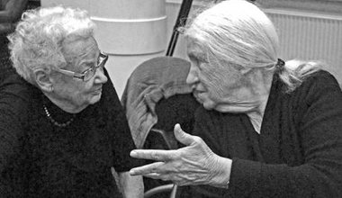 Two older women in intense discussion